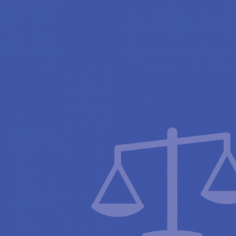 The scales of justice on a blue background.